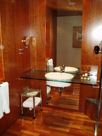 AC Hotel Aitana: sink area. Loo & shower in another part of the room separated by sliding glass door - very...