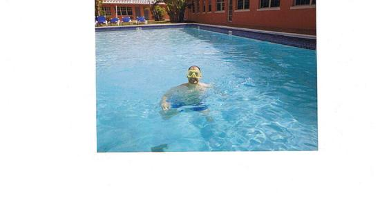 Royal Palm Resort & Suites : My Husband in The Hotel Pool