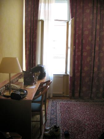 Hotel Post: Desk side of the room, including one window