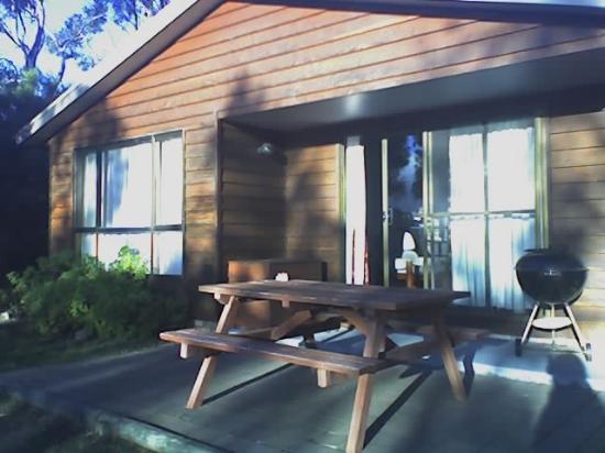 Spring Beach Villas: BBQ area, gardens and grassed area