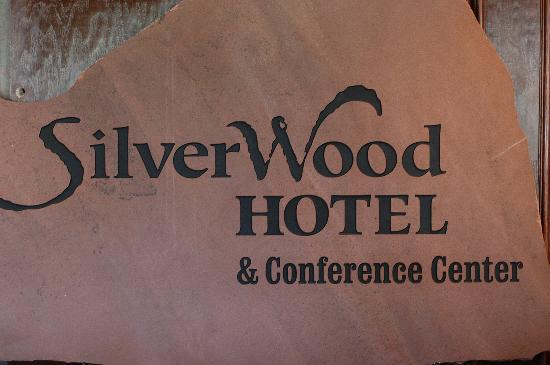 SilverWood Hotel & Conference Center: Huge stone sign behind front desk