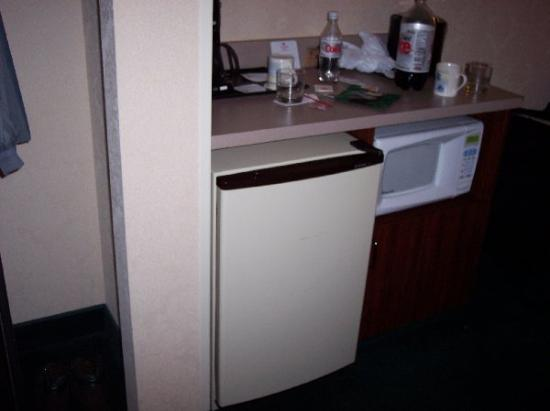 Four Points by Sheraton Portland East: Fridge, microwave, and closet. Countertop had coffee maker on it.