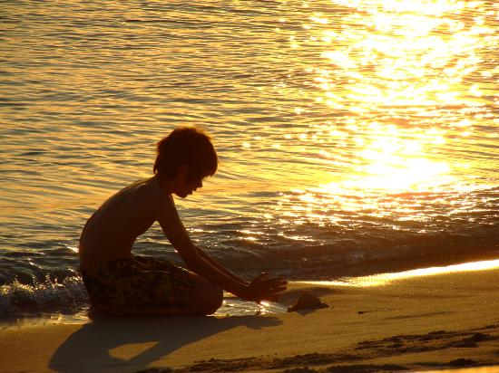 Seven Mile Beach, Grand Cayman: Boy Playing at Sunset