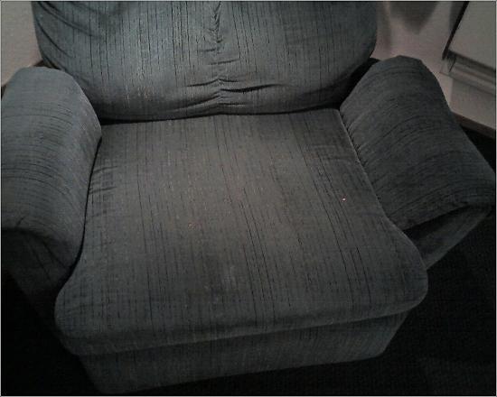 Super 8 by Wyndham El Dorado: Stains - Burns in recliner