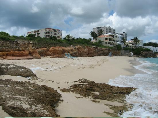 Cupecoy Bay, St. Maarten-St. Martin: Image of whole beach, villas over look, tower appts on left.