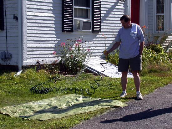 Heritage Hill Bed & Breakfast: Ron hosing down our ground cloth!