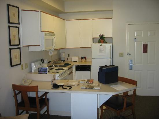 CrestHill Suites Albany: fully equiped kitchen (from the livingroom)