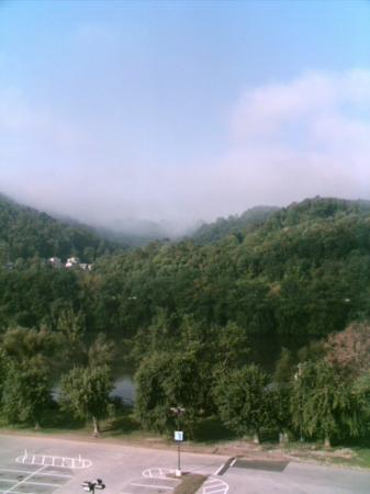 Wheeling Island Hotel Casino Racetrack: Bedroom window view - river beyond parking lot, mist in the mountains