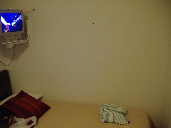 Hotel Occidental: Picture taken leaning against bookshelf/door in corner of room
