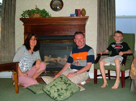 The Gananoque Inn and Spa: Our family around the room's fireplace