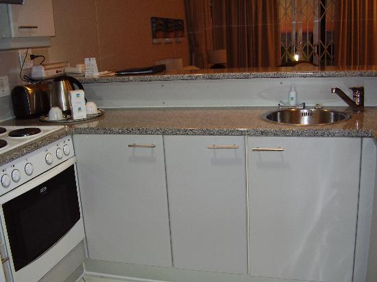 The Peninsula All-Suite Hotel: fitted kitchen