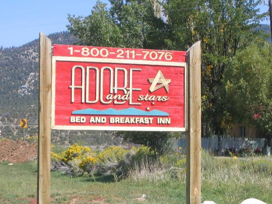 Adobe & Stars Bed and Breakfast Inn of Taos: Adobe & Stars sign with phone number