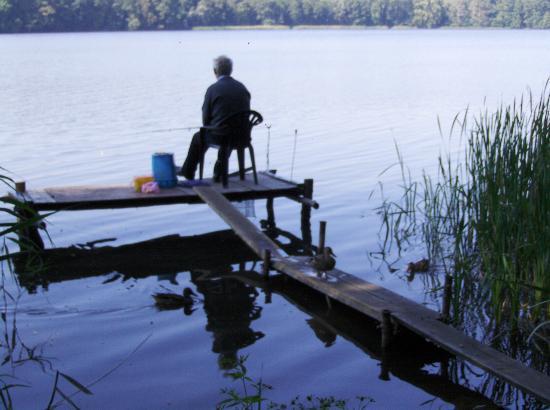 Blues Hotel: man fishing near poznan
