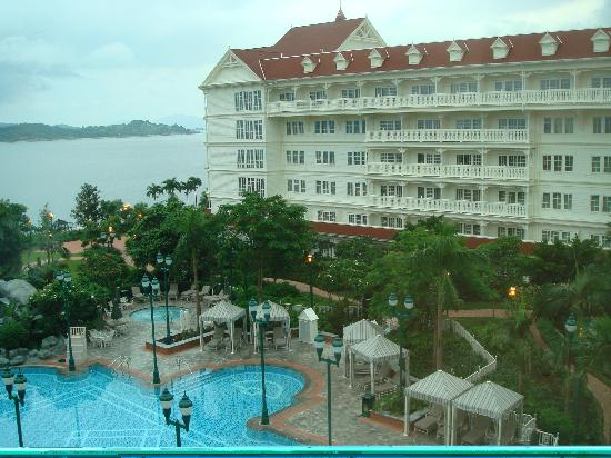 Hong Kong Disneyland Hotel : Early am view from the room down to the pool. Off camera left across the bay is Hong Kong...
