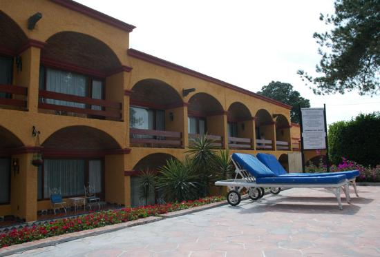 Imperio de Angeles: View of room balconies and patios from pool