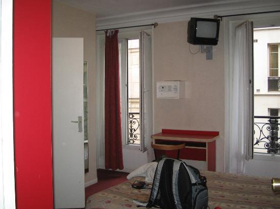 Cosmo's Hotel - twin room viewed from doorway. Bathroom is behind the open white door.