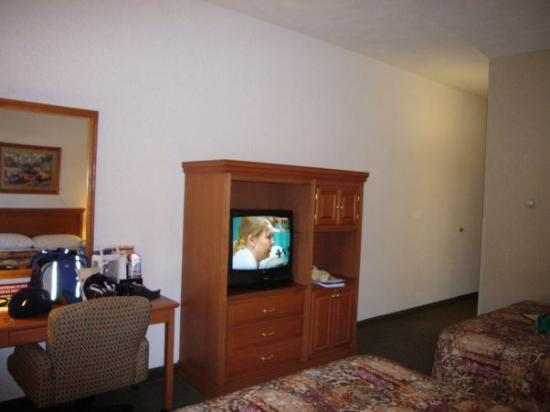 Drury Inn & Suites San Antonio Northwest Medical Center: TV Armoir, Fridge in cabinet on bottom right, Microwave, top right.  Also Coffee Maker