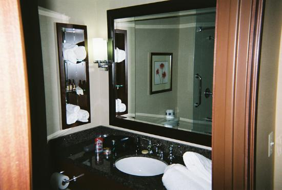 "Coralville Marriott Hotel & Conference Center: Bathroom with granite countertop, plenty of room for ""stuff"""