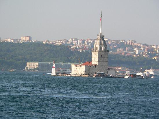 "Istanbul, Turkey: Another picture of ""Kiz Kulesi"". It's also a restaurant. At the back you see ""Ciragan palace""."