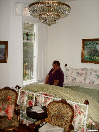The Inn at Dupont South : Me on that wonderful feather bed looking out thewindow