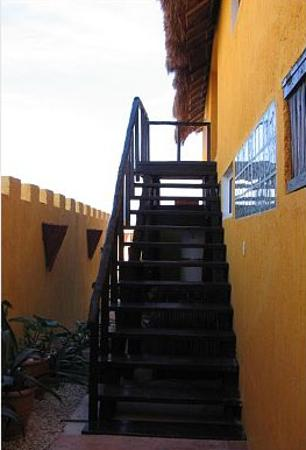 Villa La Bella: Stairs up to Palapas with swing beds