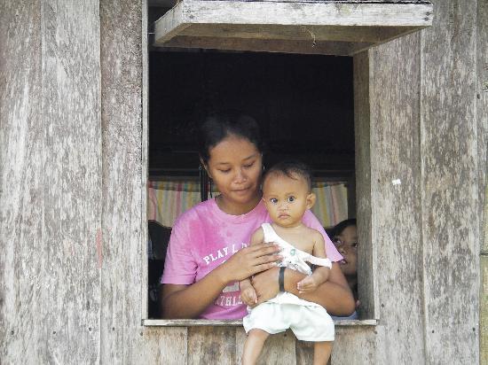 Sabah, Malaysia: mother and child in Sukau, Kinabatangan