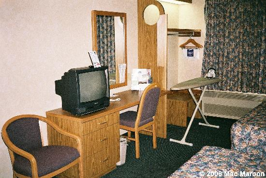 Sleep Inn: The television, desk, chair, iron/ironing board and a place where the fridge was supposed to be