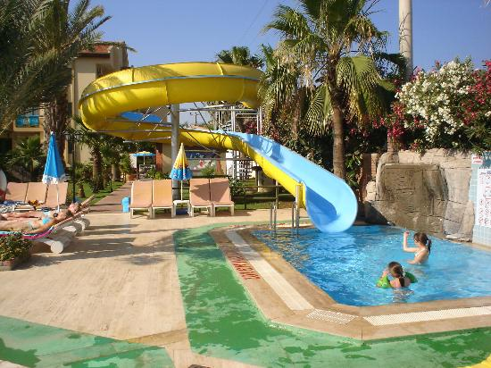 The small pool with slide picture of hibiscus hotel for Garden pool slide