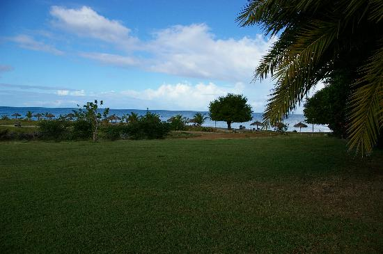Cocobay Resort: View of main beach from entrance road
