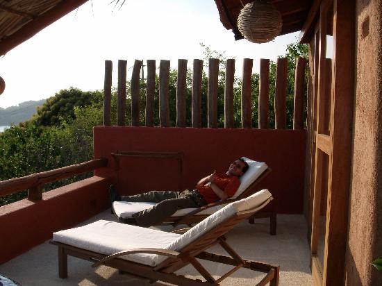 Hotel Cinco Sentidos: My husband at the sun beds