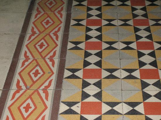 Hotel Posada Toledo & Galería: One of many patterned tile floors