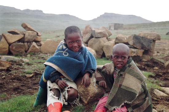 Lesotho: Wearing the traditional dress of wool blanket and rubber boots