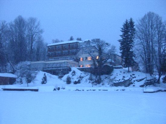 Landhaus zu Appesbach: Standing on the frozen lake looking back at the hotel at dusk
