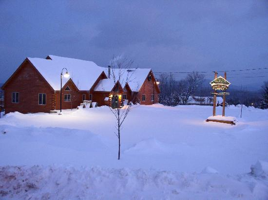Rangeley Lakes Resort Grand Lodge at dawn under 6 inches of fresh powder snow.