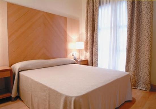 Apartamentos Ramon de la Cruz 41: foto del dormitorio, pero es mejor en realidad