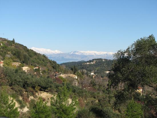 Korfu, Yunanistan: The snow covered mountains of Albania viewed from Kavadades Corfu. 06/01/2007