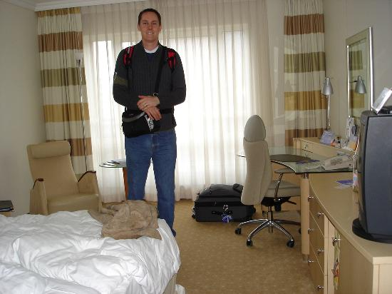 Me in the hotel room for reference i am 6 feet 10 inches for 10 feet by 10 feet room