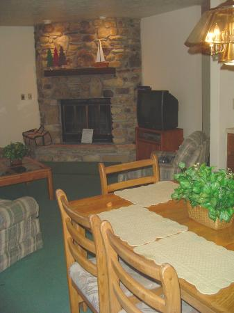 The Rushes: Fieldstone fireplace in the living room/ dining room