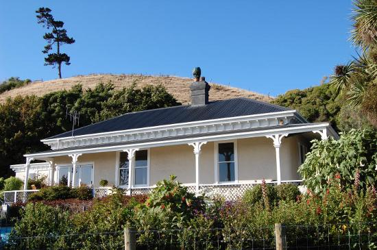 The Point Bed and Breakfast: The house in the lee of the hill behind it.