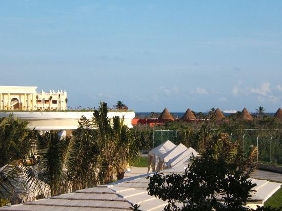 Iberostar Grand Hotel Paraiso: view from our room with honeymoon cabanas and cruise ship on horizon