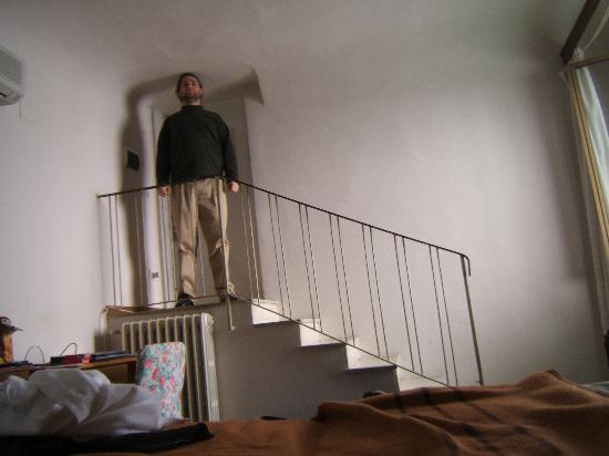 Concordia: A view of the doorway of room 26 from the bed.  The person in the photo is about 6'2.
