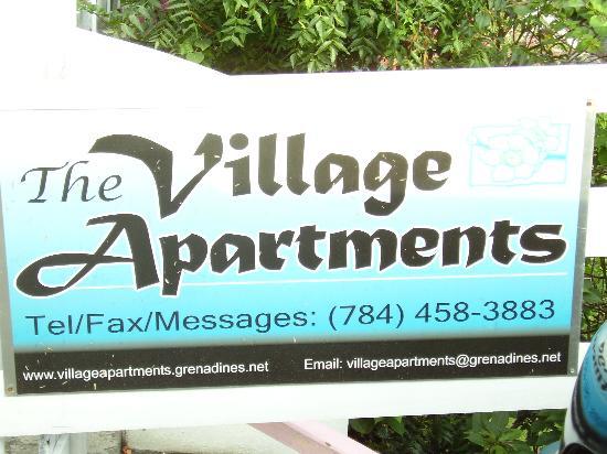 The Village Apartments: The Village Apartment sign.