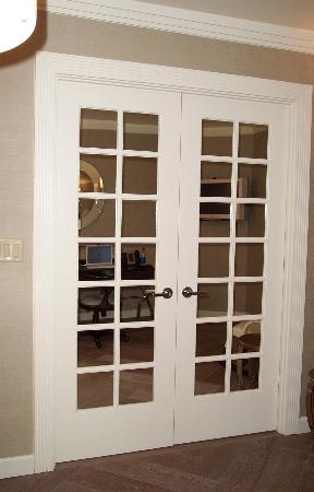 French doors leading into bedroom area - Picture of The London NYC ...