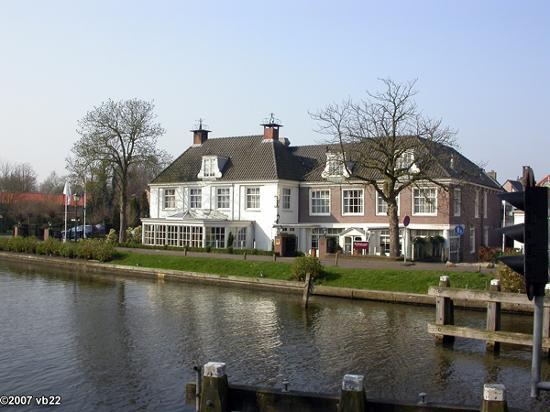 De Nederlanden: View of the hotel from across the river Vecht