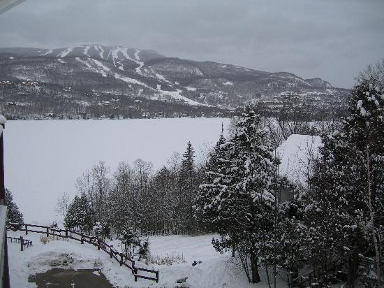 Hotel du Lac: View from our balcony The large white area is the Lake frozen and covered in snow.