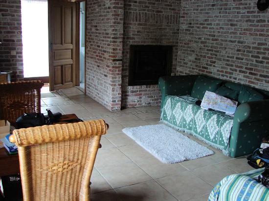 Vanhercke B&B: Living area and fireplace of