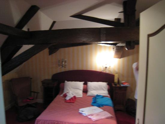 Chateau De Rigny : My sister's room under the roof - with beams. Very nice.