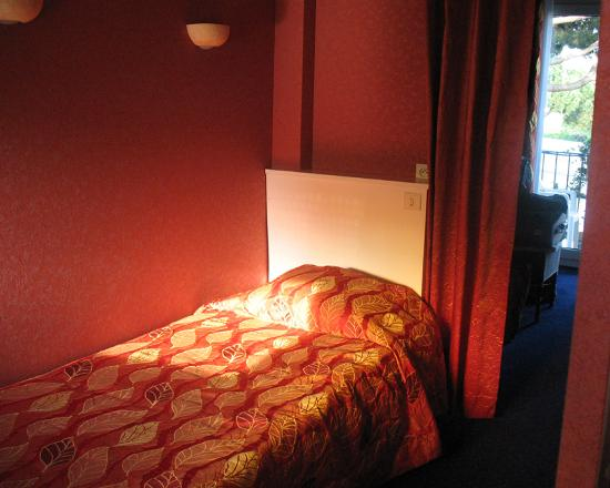 Hotel Olivier: View of room from area with 3rd bed (larger portion past curtain)