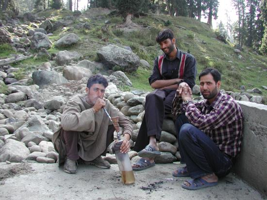 Srinagar, India: Young men smoking near Gulmarg