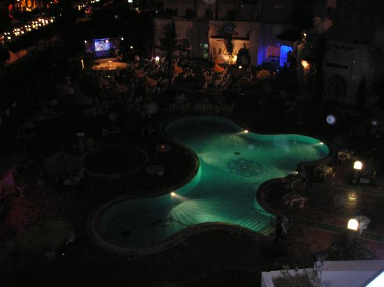 Houria Palace Hotel: Pool at night